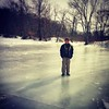 Jack on the ice on a pond near home.
