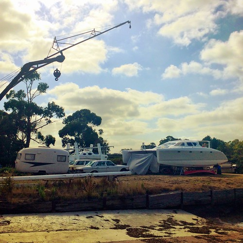 Catamaran, cars, caravan and crane.