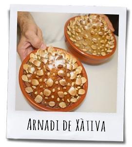 Arnadi is een typisch nagerecht van Xàtiva op basis van pompoen, kaneel en citroen dat gedecoreerd wordt met amandelen