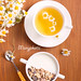 Muesli mix with yogurt in a bowl and chamomile tea