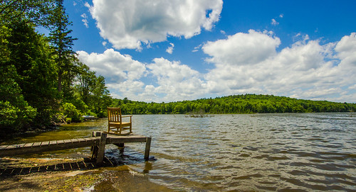 sky lake water clouds landscape dock chair rockingchair odc hbm canon1022mmlens withinthemoment