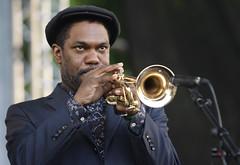 singer(0.0), saxophone(0.0), guitarist(0.0), singing(0.0), musician(1.0), trumpet(1.0), music(1.0), trumpeter(1.0), jazz(1.0), brass instrument(1.0),
