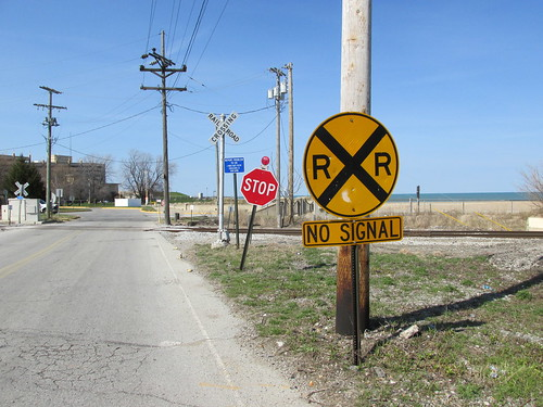 Signs at a railroad crossing.  Hammond Indiana.  Sunday, April 21st, 2013. by Eddie from Chicago