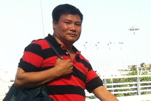 Ông Trương Duy Nhất được đưa ra Sân bay Đà Nẵng để di lý ra Hà Nội phục vụ công tác điều tra (ảnh chụp lúc 15g10 ngày 26/5 tại Sân bay Đà Nẵng) - Ảnh: Đ. Nam