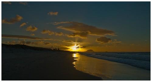 ocean morning pink sunset red newzealand sky orange cloud sun reflection beach nature water beautiful beauty silhouette night clouds sunrise fun amazing sand nikon warm pretty surf waves view gorgeous horizon wave surfing riding shore nz northisland nikkor seashore mtmaunganui tauranga photooftheday bayofplenty d300 nouvellezélande papamoa waterfoam nikond300 allsunsets papamoanz nikkorvr18105mmf35 bernzfotos