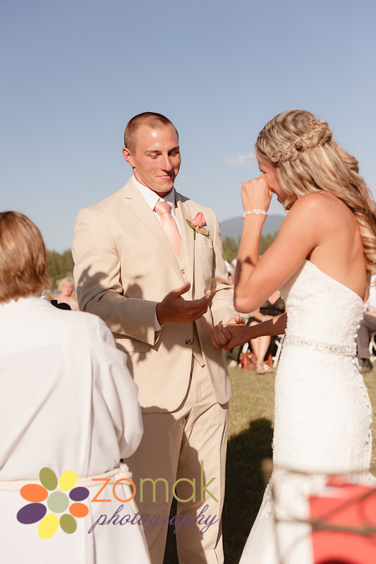 Bride reacts emotionally while groom says his vows.