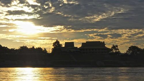 travel sunset river boat asia southeastasia cloudy laos mekong luangprabang laopdr
