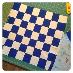 Frances's first quilting WIP: a checkerboard. I did the slicing and pinning, but the sewing was all her.