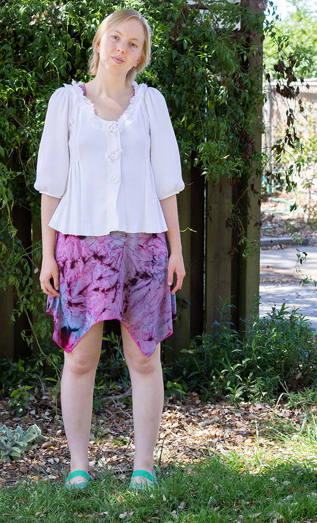 white cardigan with bell sleeves, purple tie-dye patterned dress