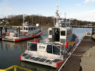 A new 45-foot response boat (right) sits moored at Coast Guard Station Marblehead, Ohio, after the station's crew took acceptance of it May 1, 2014.  The new boat will help increase the crew's ability to respond to search and rescue cases and will complement the station's three other response boats.  U.S. Coast Guard photo by Petty Officer 1st Class Phillip Null