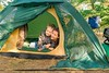 mother and son in a tent on the nature