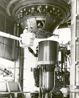 The first ground experimental nuclear rocket engine assembly being installed in Engine Test Stand No. 1 at the Nuclear Rocket Development Station in Jackass Flats, Nevada
