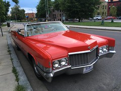 Red Cadillac convertible parked on Vermont Avenue NW, Washington, D.C.