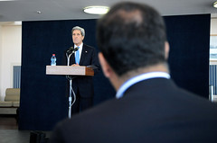 Secretary Kerry Listens as Reuters' Arshad Mohammed Asks a Question