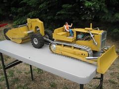 asphalt(0.0), light commercial vehicle(0.0), harvester(0.0), cart(0.0), vehicle(1.0), construction equipment(1.0), bulldozer(1.0), land vehicle(1.0),