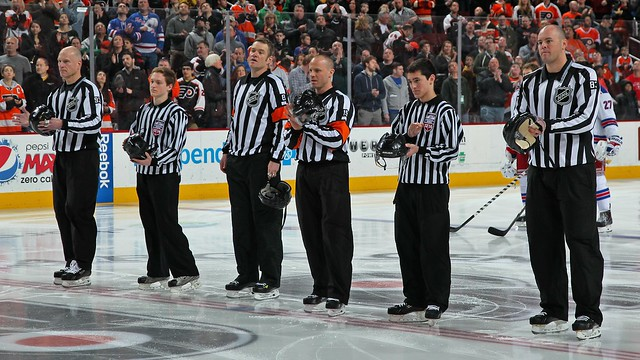 Eric Sailor and Charlie Van Kula Join NHL Officials at Center Ice