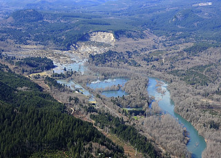 Aerial photo of the mudslide and backup of Stillaguamish River
