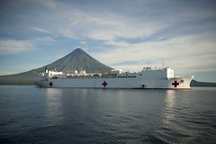 USNS Mercy (T-AH 19) sits anchored off the coast of Legazpi, Philippines, with Mount Mayon in the distance during the second mission stop of Pacific Partnership 2016. (U.S. Navy/MC1 Elizabeth Merriam)