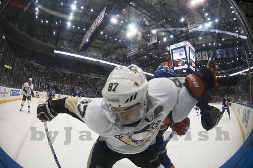 Sidney Crosby along the glass by Jai Agnish