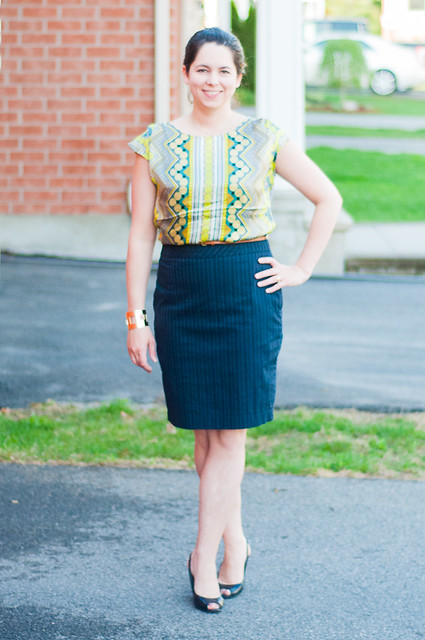 navy skirt, neon print top black shoes