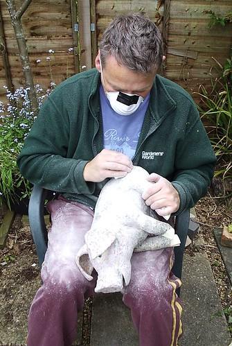 sanding paper maché pig
