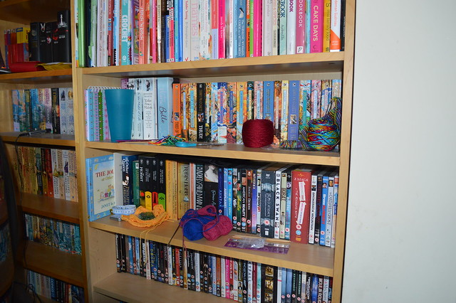 Knitting and crochet junk on book shelves