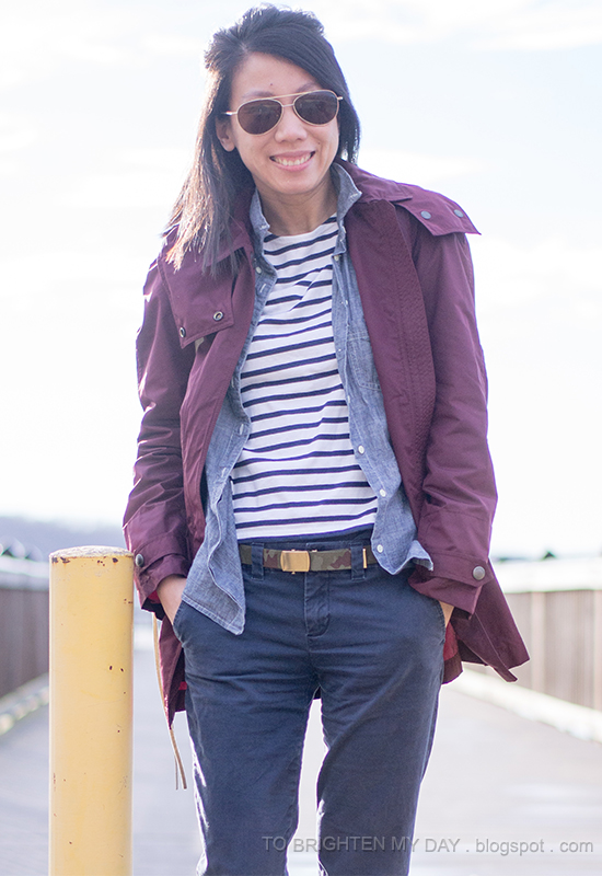 dark red jacket, chambray shirt, striped top, navy khakis, camo belt