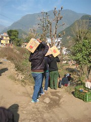 Books funded by NLF being delivered to a library in Lamjung