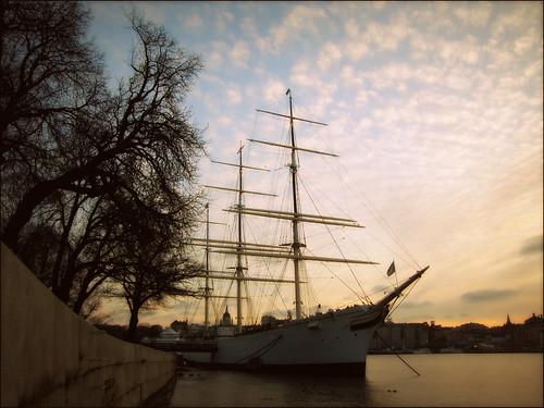 trees sunset sky water evening hostel ship sweden stockholm quay skeppsholmen strömmen afchapman