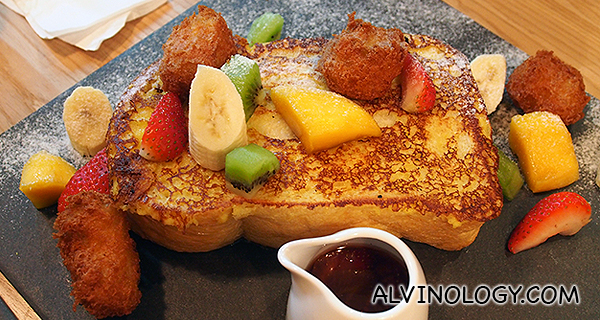 French Toast Salpicon - Chicken, spinach and mushrooms stuffed in French toast, banana nuggets, mixed berries, strawberry-smoked maple syrup (S$19)