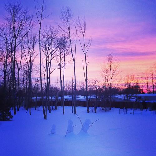 Snowmen at sunset