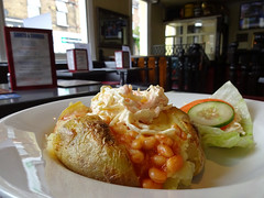 Jacket potato with cheese, beans, and coleslaw at…