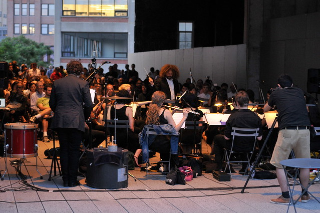 A performance of Crickets by Mungo Thomson in the 14th street passage at the High Line; the piece reconstructs with strings, winds, and percussion the sounds of various wildlife from around the world. Listen to a snippet here.