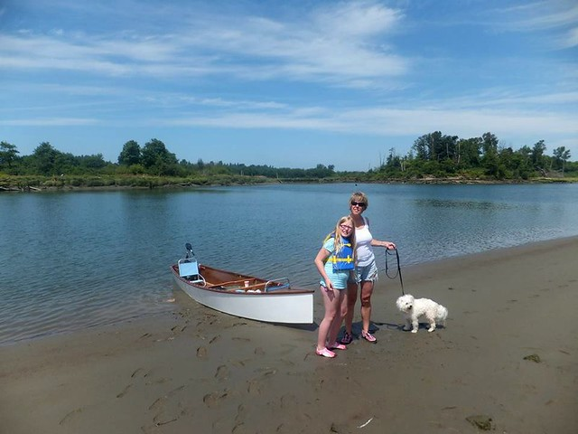 Three people and a dog spend a day travelling around the Snohomish Estuary looking at boats and picnicing.