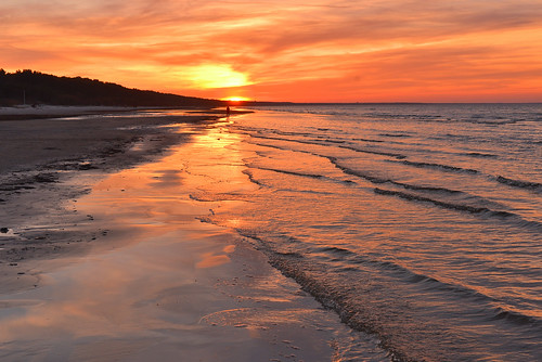 sunset sea orange sun beach water evening bay march spring sand warm wave calm baltic latvia resort riga jurmala