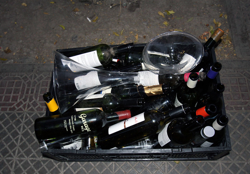 bottles on the ground in a crate
