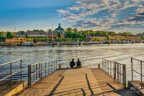 Couple sitting at the docks in Djurgården, Stockholm