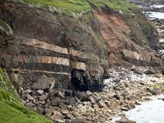 wall(0.0), valley(0.0), ridge(0.0), coast(0.0), badlands(0.0), outcrop(1.0), rockfall(1.0), formation(1.0), geology(1.0), bedrock(1.0), terrain(1.0), wadi(1.0), rock(1.0), cliff(1.0),