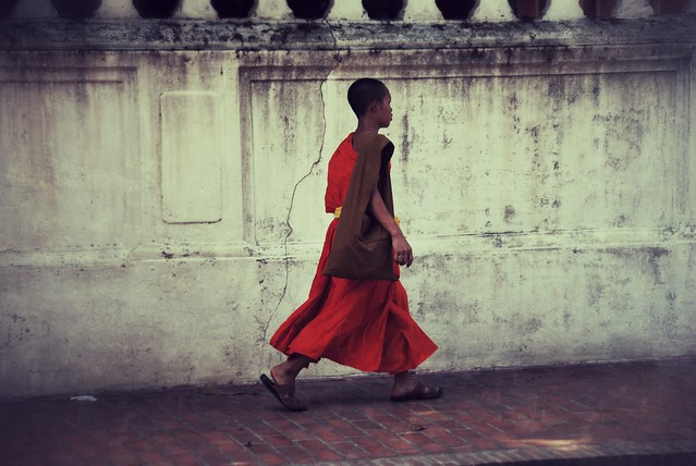Monk walking in Luang Prabang, Laos.