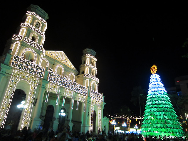 A broader view of Envigado's church, and the Christmas tree of lights in front of it