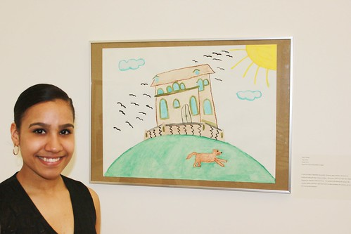 Proud student with her art