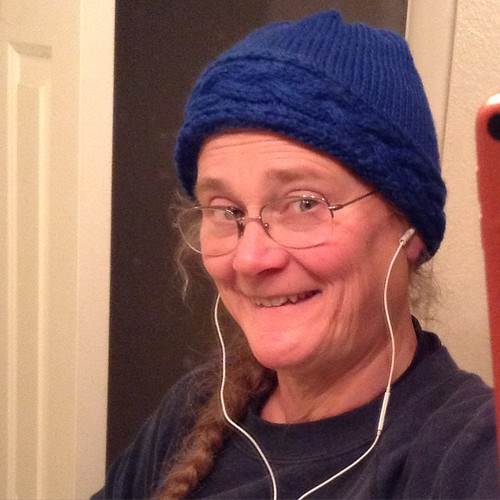 The TARDIS Coronet Hat for Twinface is done! And I'm listening to Twinset Designs Podcast BTW as I model it.