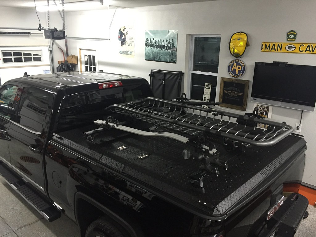 A Rack System And Truck Bed Cover On A Chevy Gmc Silverado