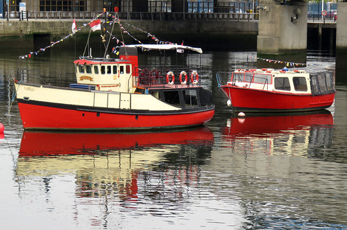 Red boats in the Belfast harbour, Ireland