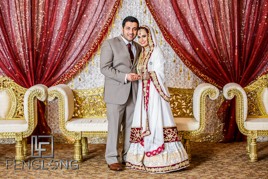 Bride And Groom Posing For Formal Portrait Photo At Indian Wedding Reception