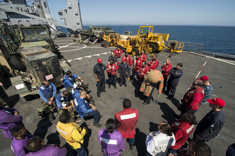 PACIFIC OCEAN - Chief Damage Controlman Rico Ibarra gives a wrap-up brief after an aircraft crash drill aboard the flight deck of amphibious dock landing ship USS Harper's Ferry (LSD 49).