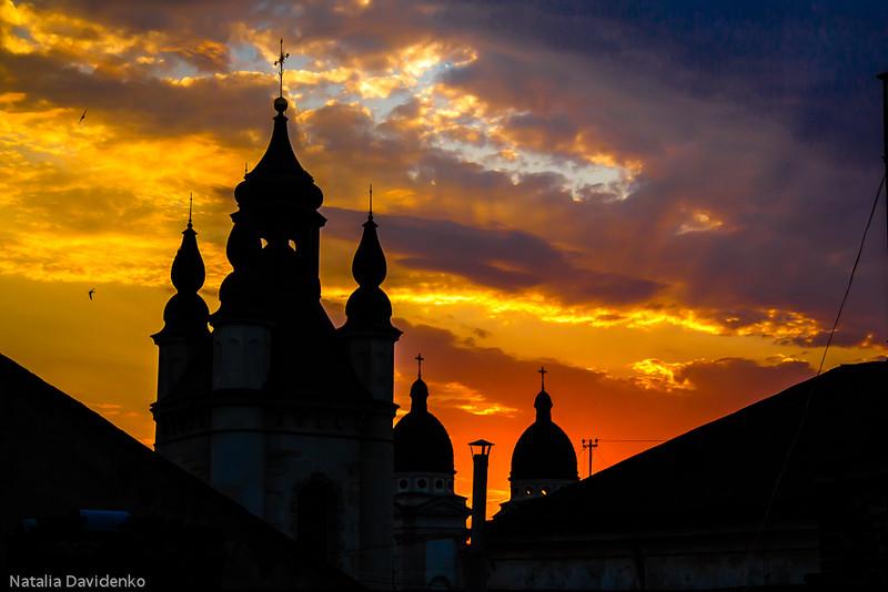 Church in a sunset beams in Lviv, Ukraine. Sunshine church contour