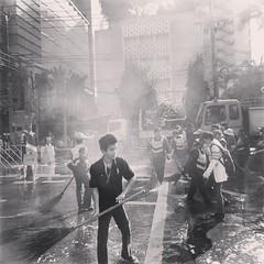 Keeping the #shutdown clean | An army of street sweepers backed by heavy water cannons is cleaning the Asoke barricade.  | #blackandwhite #bangkok #thailand #2014