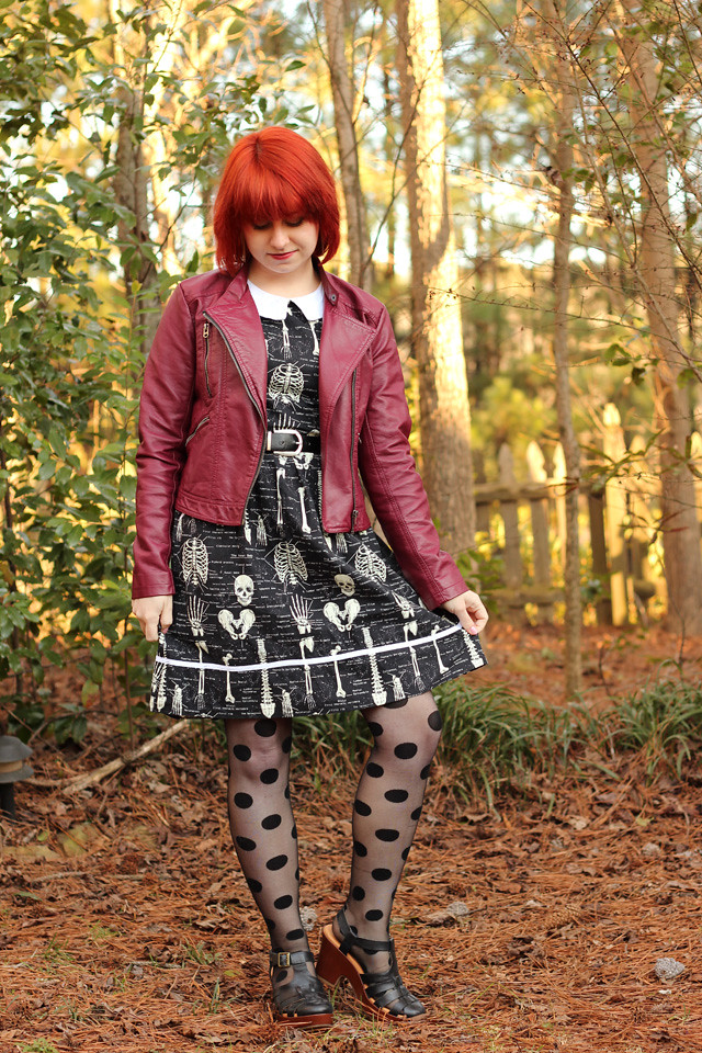 Black Skeleton Anatomy Dress, Burgundy Leather Jacket, and Polka Dot Tights