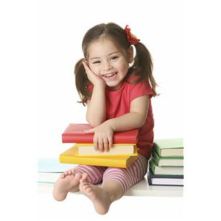4 year old girl with books in lap